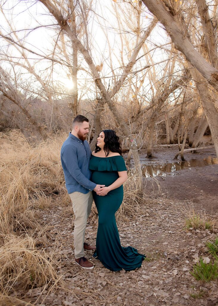 Outdoor maternity shoot with husband and wife at sunset.